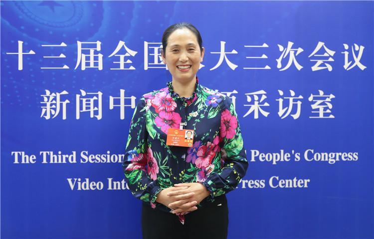 谭建兰(全国人大代表)重庆日报全媒体记者(4648655)-20200523185837.jpg